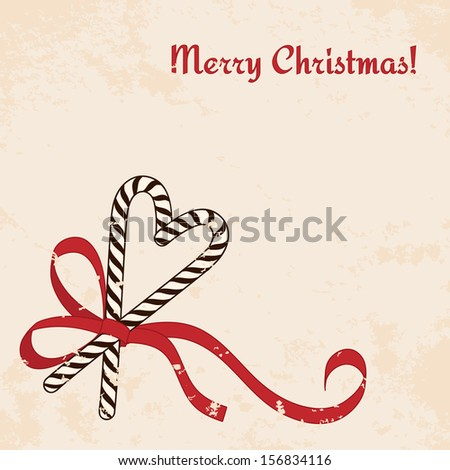 Christmas candies cane with ribbon - vintage christmas card - stock photo