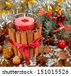 Christmas candle and decorations on a brown background - stock