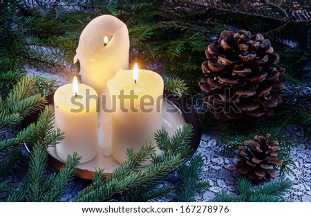 Christmas candle, cone and spruce branches - stock photo