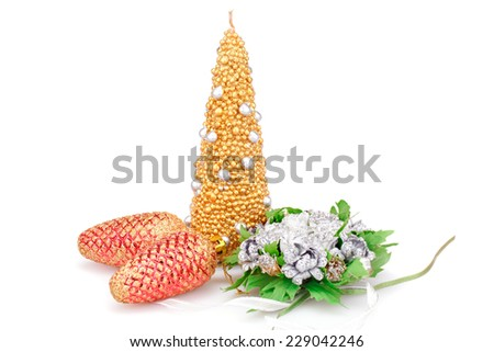 Christmas candle, flowers and cones isolated on white background. - stock photo