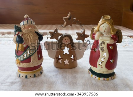 Christmas candle holder on scott fabric in living room. - stock photo