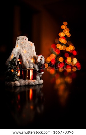 Christmas Candle house on a colourful background - stock photo