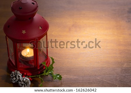 christmas candle lamp with decoration on wooden
