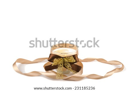 Christmas candle with ribbon - stock photo