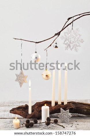 Christmas candles and handmade decorations on white  - stock photo