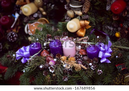 Christmas candles and ribbons on pine garland decoration