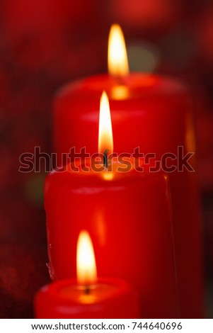 Christmas candles in red. Decoration for holidays