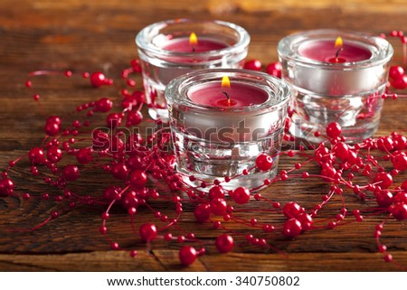 Christmas candles on wooden planks background