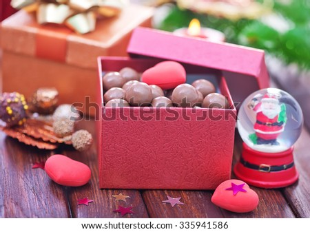 christmas candy and christmas decoration on a table - stock photo