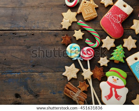 christmas candy and cookies on rustic background, food top view