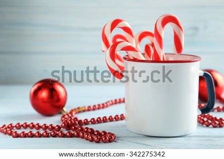 Christmas candy can on a blue wooden table
