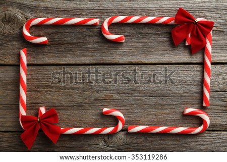 Christmas candy can on a grey wooden table - stock photo