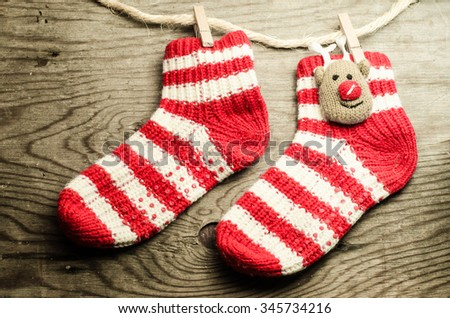 Christmas card,Christmas decoration, socks and toys on a rustic wooden background,horizontal photo - stock photo