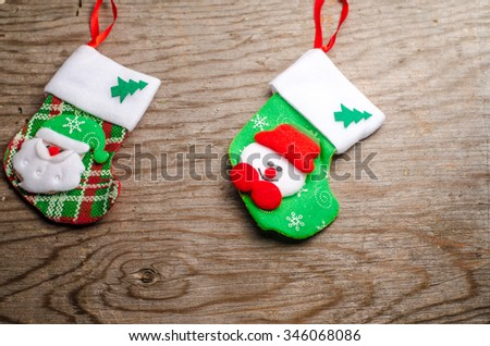 Christmas card, Christmas ornaments, socks and toys on wooden background, horizontal photo