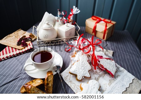 Christmas card composition with cake, gingerbread on grey wooden background.