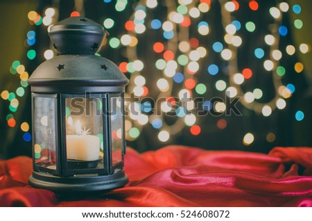 Christmas card. Holiday lantern on the bright blurred Xmas lights background, space for your text, copyspace. Christmas wallpaper.