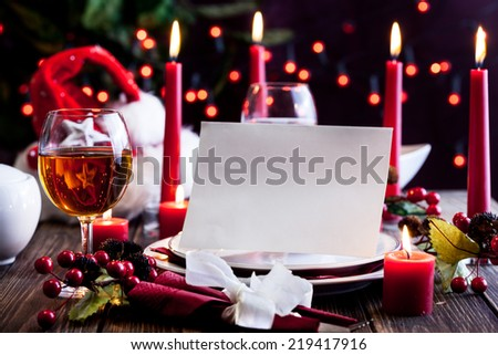 Christmas card in dishware at the wooden table