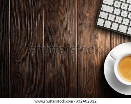 Christmas card. Keyboard, cup of coffee on a wooden background - stock photo