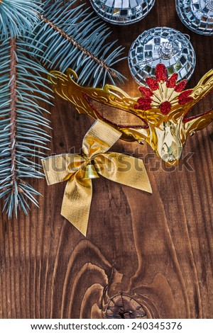 christmas card mirror disco three balls gold colored bow carnaval mask and pine tree branch on old wooden board with copyspace - stock photo