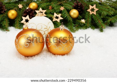 Christmas card: three balls and Christmas tree border with decorations on white - stock photo
