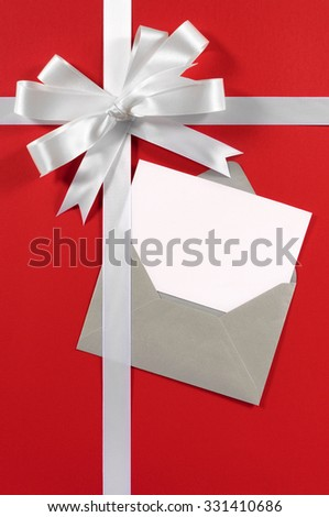 Christmas card, white gift ribbon bow, red paper background vertical, copy space - stock photo