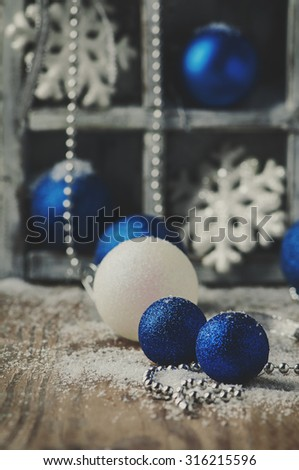 Christmas card with balls on the wooden table, selective focus and toned image - stock photo