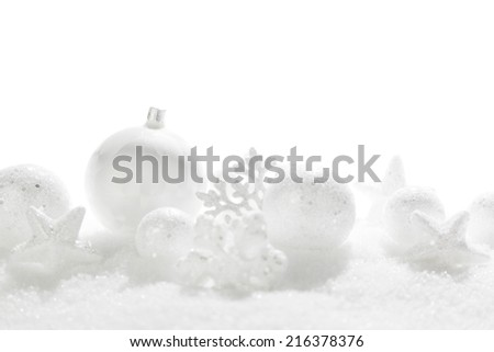 Christmas card with beautiful white decorations in snow - stock photo