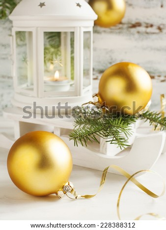 Christmas card with candle lantern and sledge on wooden background. - stock photo