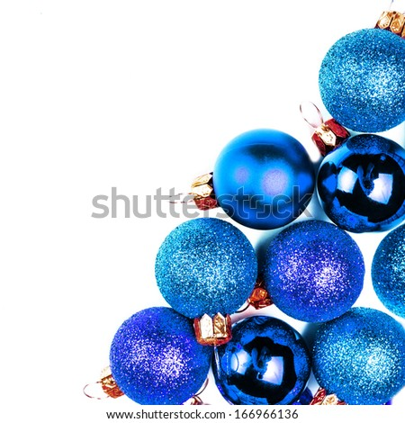 Christmas card with Christmas Ornaments isolated on white backhround. Festive glittering blue balls close up with copy space for greeting text. - stock photo