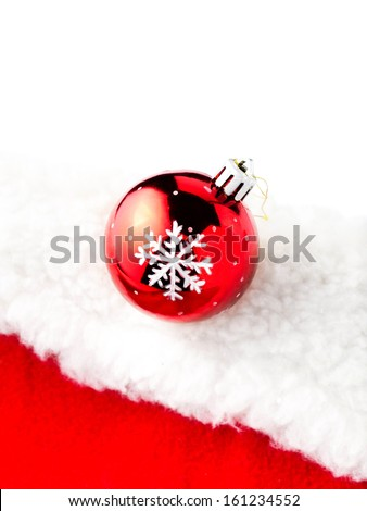 Christmas card with copy space - Christmas bauble on white and red background.  - stock photo