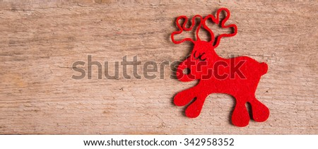 christmas card with  decor and rudolph reindeer on wood background - stock photo