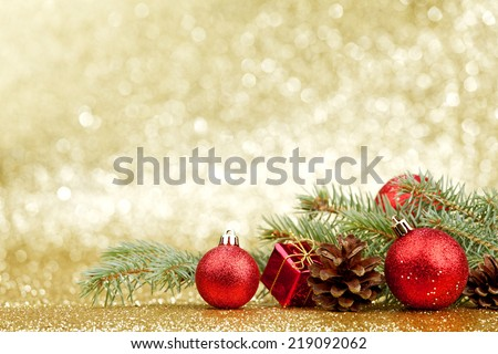 Christmas card with fir and decor on glitter background - stock photo