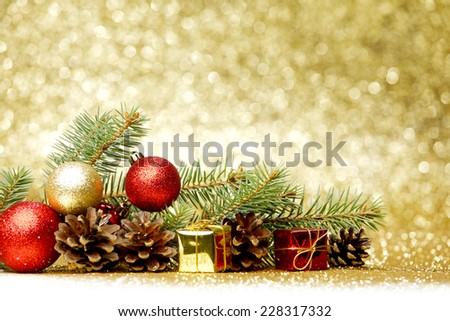 Christmas card with fir, balls and presents on glitter background - stock photo