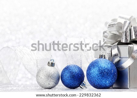 Christmas card with gift and decorative balls close-up
