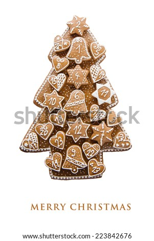 Christmas card with homemade gingerbread advent calendar, isolated on white background - stock photo