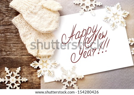 Christmas Card with Message Happy New Year on the letter isolated on white, decorated snowflakes and mittens - stock photo