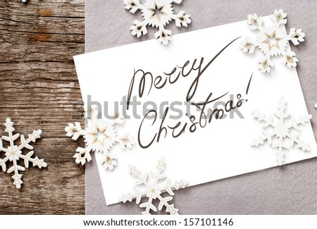 Christmas Card with Message Merry Christmas on the letter isolated on white, decorated snowflakes