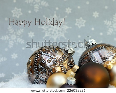 Christmas card with ornaments saying ; Happy Holidays !