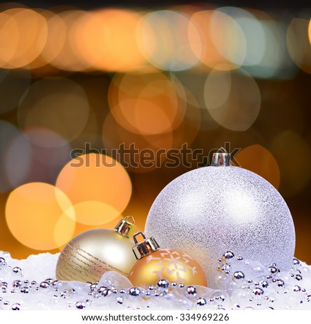 Christmas card with red toys, balls, bells, stars and bokeh lights