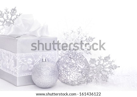 Christmas card with silver gift and decoration on white - stock photo