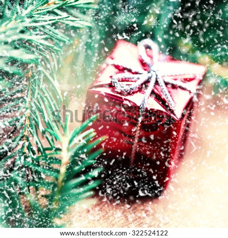 Christmas card with  snowflakes, present box and fir cone tree on wooden background close up. Christmas composition  with decorations - stock photo