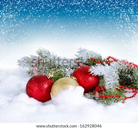 Christmas card with sparkle  balls and fur tree on the snow - stock photo