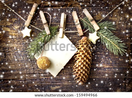 christmas card with stars,fir and  fir-cone on wooden background/ Christmas card with christmas natural decorations - stock photo