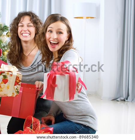 Christmas celebration. Friends with Christmas Gifts . New Year party - stock photo