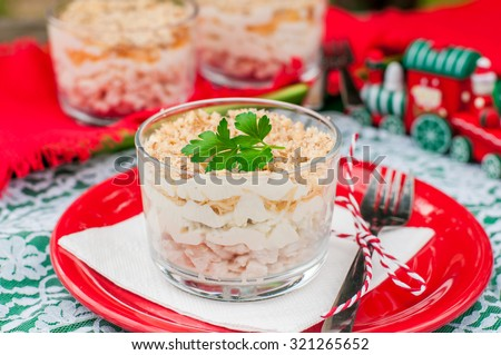 Christmas Chicken, Apple, Cheese and Egg Salad Layered with Mayonnaise Served in Individual Cups - stock photo