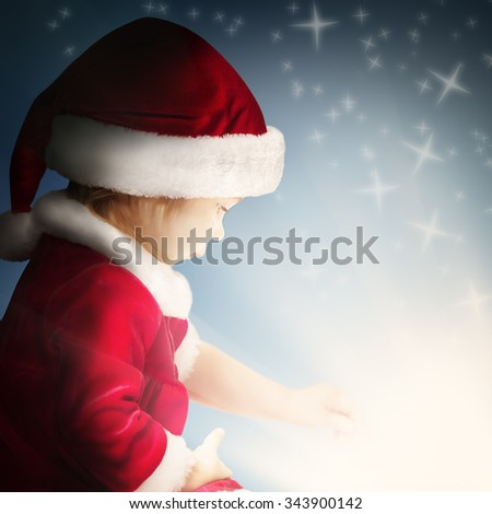Christmas Child Open Gift on Background with Sparkle and Glitter - stock photo