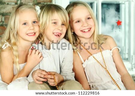 Christmas children - cheerful smiling kids - stock photo