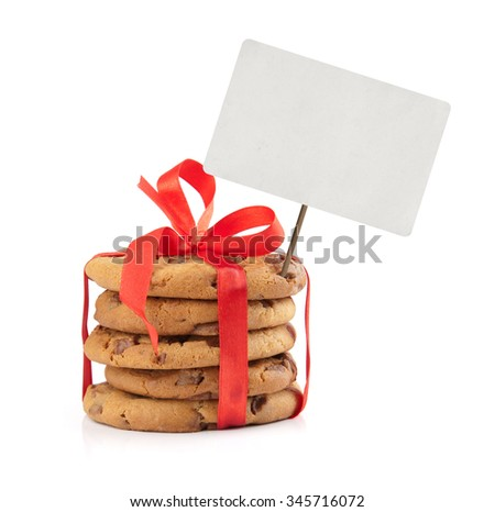 christmas chocolate chip cookies and red ribbon with price tag isolated on white - stock photo