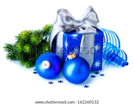 Christmas. Christmas Gift Box and Decorations isolated on White Background. Design Composition. Blue Color. Present Box Decorated with Silver Satin Ribbon and Beautiful big Bow - stock photo
