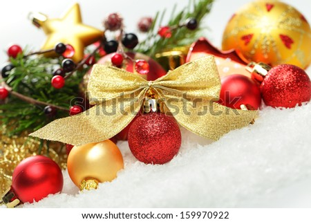 Christmas. Christmas holiday decorations on white background, white snow with decoration - stock photo